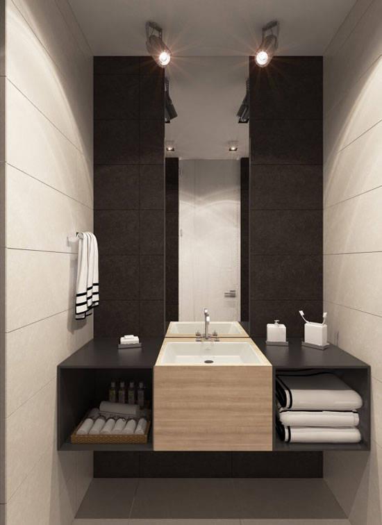开放格局前卫空间现代大户型公寓设计 客厅、厨房、餐厅三大功能区以开放的方式合并在一起,使得公共空间畅通无阻,宽阔敞亮。原木色应用在了地板、橱柜、墙面等各个区域,营造自然氛围。深色沙发则更具厚实感与稳重感。厨房与客厅间用原木栅条做了隔断,美观而不影响视线。餐厅吊顶同样使用了木栅条,富有视觉层次。餐厅边的空余墙面被打造成了内嵌式书架,电视墙上也打造了收纳分格,让空间实用性更强。 【活泼实用的双人儿童房】
