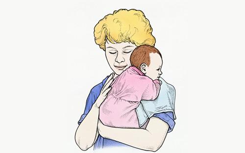 婴儿抱奶瓶矢量图