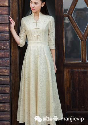 蕾丝花纹面料搭配高腰大摆裙设计