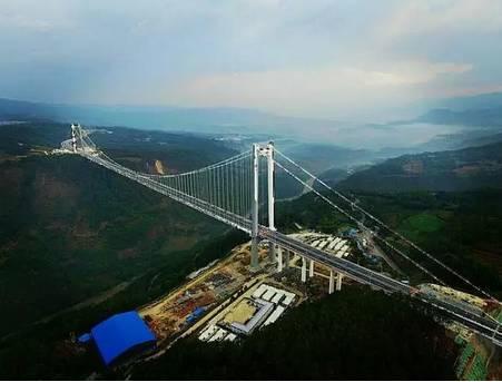 旅游 正文  龙江大桥建成,一头连着魏魏高黎贡山,一头连着极边腾冲,一图片