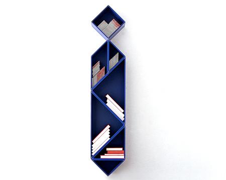 """由几何形体拼接成的书架,改变了图书固有的垂直或水平摆放的方式,给人一种""""挂在墙上的领带""""的形式美感."""