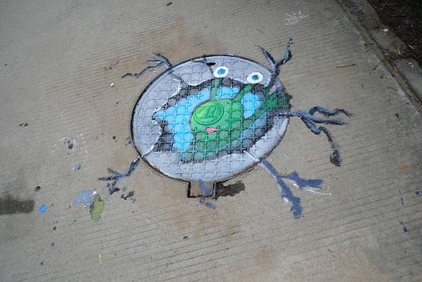 手绘环保井盖图片
