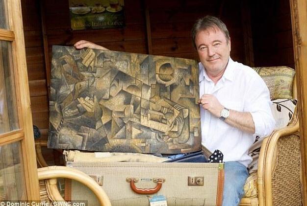 男子发现旧保险箱 打开乐坏了!(图)