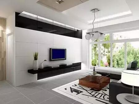 白色的柜子作为电视背景墙,实用大方,整齐的格子间可以摆放各种东西.图片