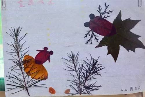 凤凰镇梧台小学树叶粘贴画 留住秋天