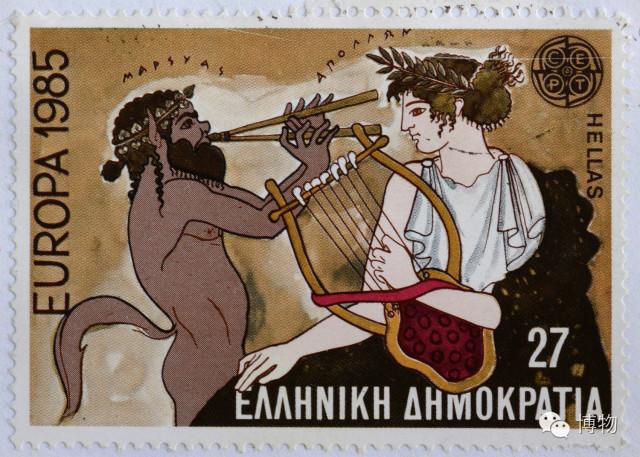 下图的邮票中所描述的,就是潘用这支乐器与太阳神阿波罗的里拉琴比赛图片