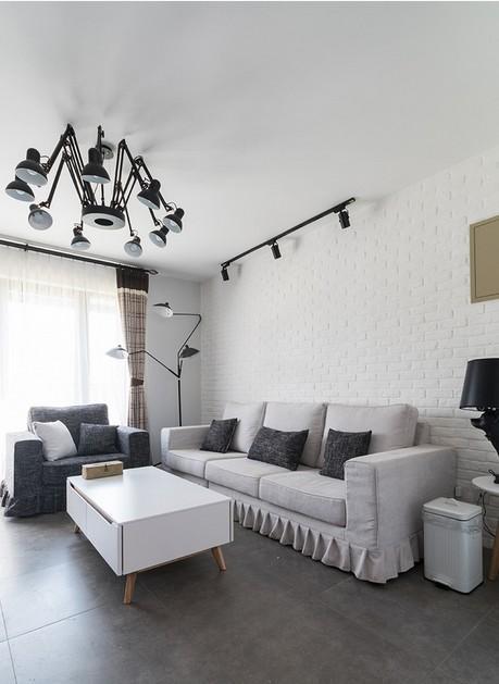 无论是工业风吊灯还是家具的选择,都使客厅看起来富有创意与优雅.图片