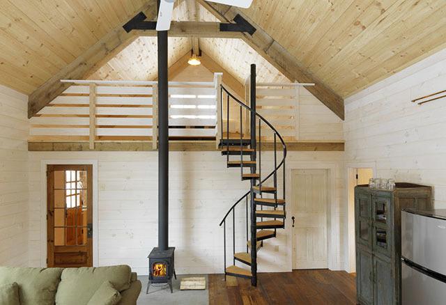 扶手线条灵动的楼梯设计,一点不显厚重,也几乎没有占多少空间.