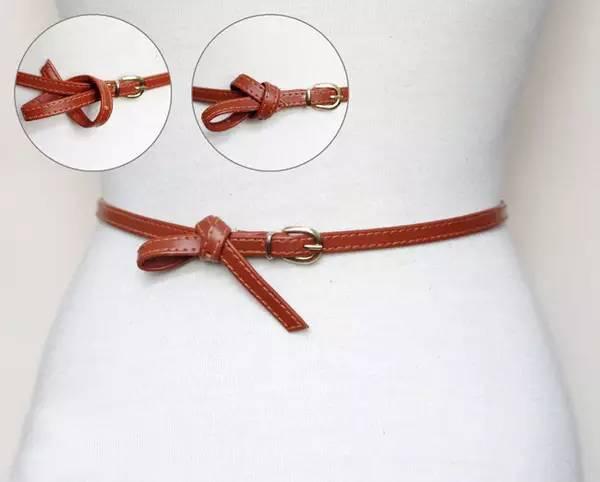 领结扣的系法很容易让腰带剩余很多哦,除了选择稍微短点的腰带,还可以