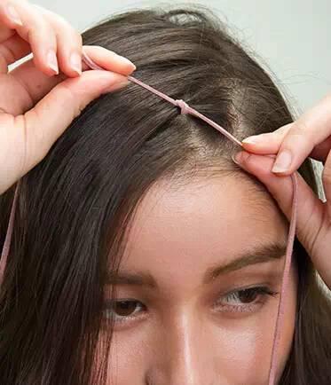 第二款:少女感   step1:用卷发棒将头发烫出自然的卷度.图片