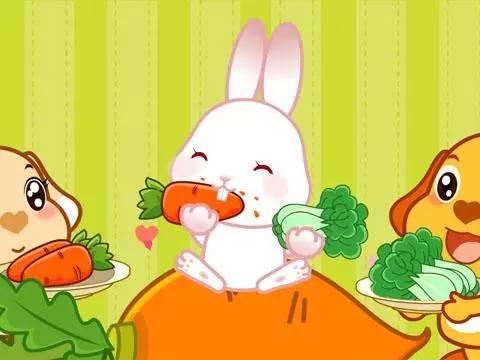 两只耳朵竖起来.爱吃萝卜和青菜,蹦蹦跳跳真可爱.图片