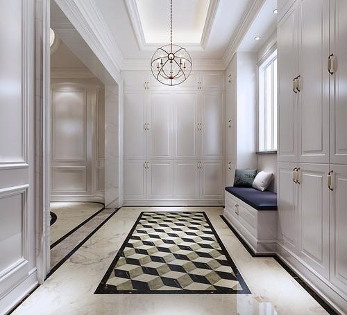 将储物柜和换鞋凳布置在这一侧,延续玄关的简白设计,地板拼花则采用立图片