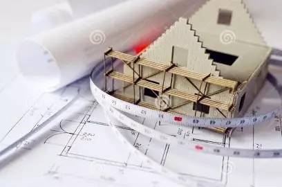 with scaffolding on architecture blueprint plan at desk