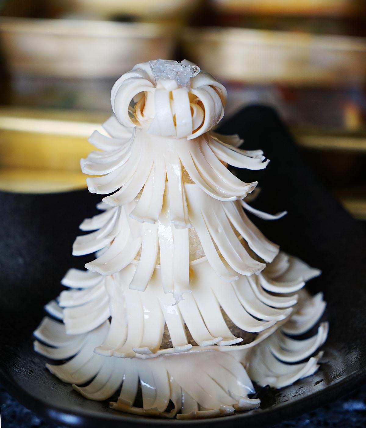 比起一些火锅店粗放的摆盘方式,王家渡的菜品摆盘精致,让请客的人