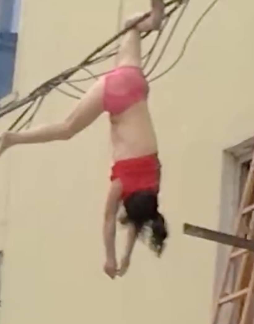 女子穿内衣裤坠楼,倒挂电线上,竟是因为 现场视频曝光
