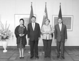 习近平会见德国总理默克尔(图)