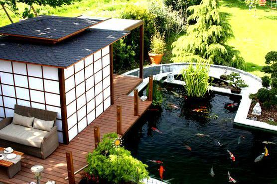 分享7个家庭庭院鱼池设计图片