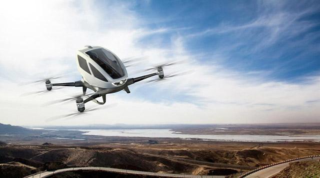 據了解,這種無人飛機可以運送一名乘客,最大載重量為100千克.圖片